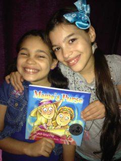 Elisha and Elyssa after reading Mama's Purse by AJ Irving