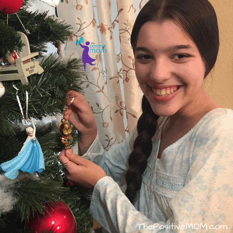Elisha excited about her C3PO tree ornament and StarWars
