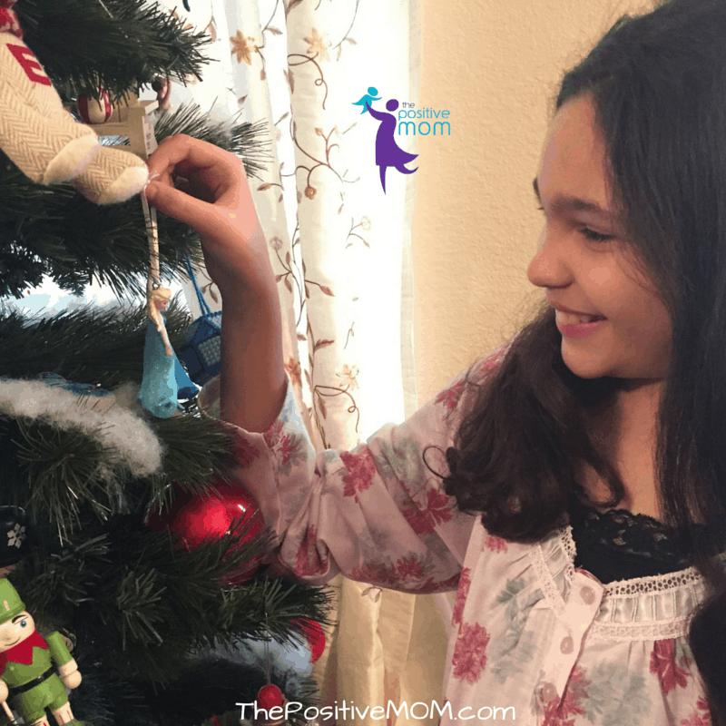 Queen Elyssa contemplates her Queen Elsa ornament