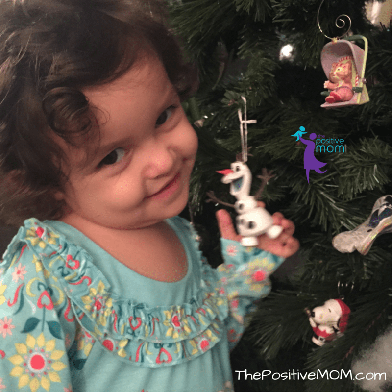 Little Pige loves her new Olaf ornament - she wants to play with him!