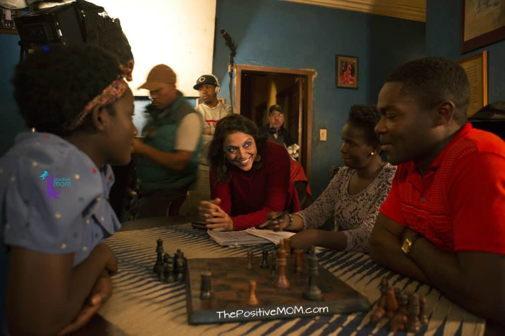 Queen Of Katwe Director Mira Nair with actors filming a chess scene