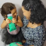 Mom and Baby bonding time : using Johnson's No More Tangles
