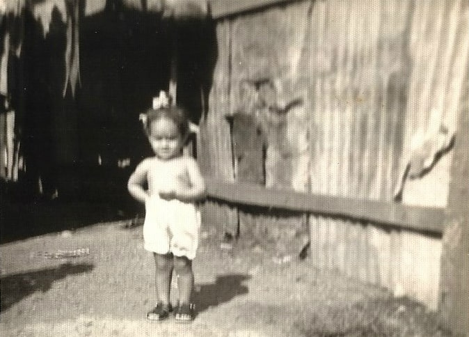 Elayna Fernandez - childhood photo in a Dominican Republic slum