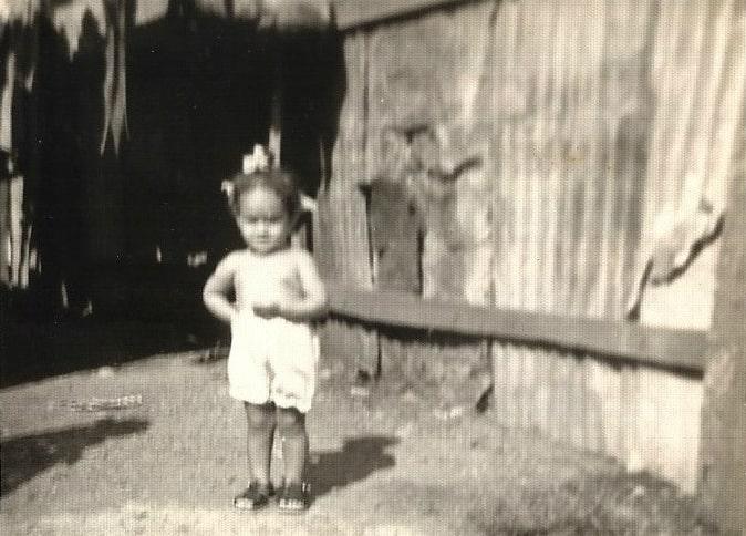 Elayna Fernandez - childhood photo in a Dominican Republic slum