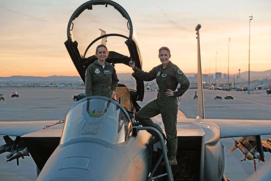 """Marvel Studios' CAPTAIN MARVEL  Brie Larson (left) gets hands-on help from Brigadier General Jeannie Leavitt, 57th Wing Commander (right), on a recent trip to Nellis Air Force Base in Nevada to research her character, Carol Danvers aka Captain Marvel, for Marvel Studios' """"Captain Marvel.""""  Photo: Brad Baruh  ©Marvel Studios 2019"""