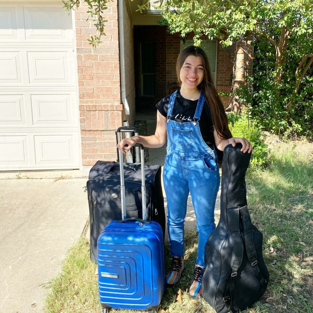 Daughter with suitcases going to college